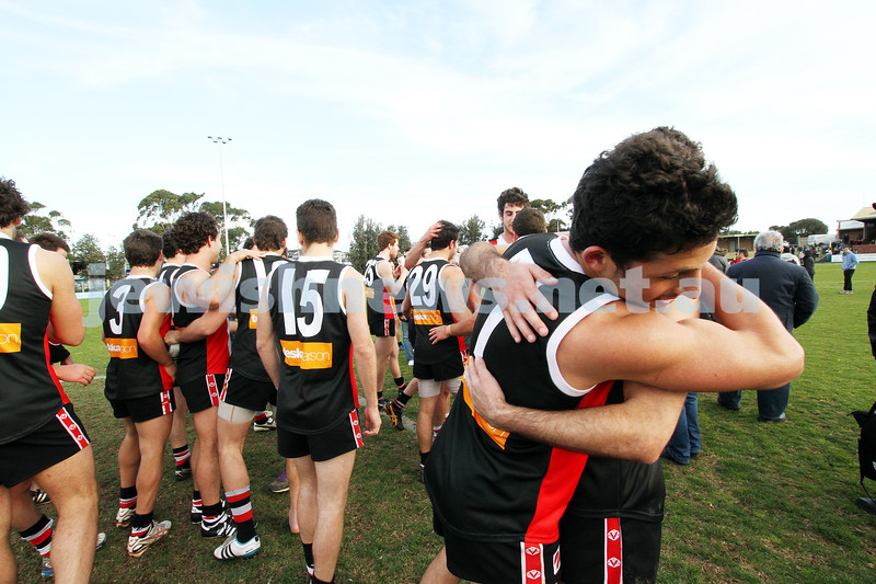 10-9-11. Ajax V Old Camberwell, Preliminary Final. Celebrating their huge win. Marcus Jankie embraces a team mate. Photo: Peter Haskin