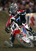 """Kevin Windham (#14) in action at Angel Stadium in Anaheim, California on February 3, 2007 for Round 3 of the Amp'd Mobile/AMA Supercross Series.  Windham finished seventh behind James """"Bubba"""" Stewart in the 250cc Main Event."""