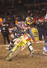 "Racers from around the world converged on Angel Stadium in Anaheim California on January 3, 2009 for the opener of the 2009 Monster Energy AMA Supercross series.  Reigning champion Chad Reed (#1) battled with James ""Bubba"" Stewart until they collided in lap 6, opening the door for first-timer Josh Grant to take the win."