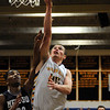 CARL RUSSO/Staff photo. Andover defeated Medford 68-60 in boys' tournament basketball action Tuesday night. Andover's captain, Sam Dowden drives to the hoop for the basket.   2/26/2013.