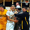 CARL RUSSO/Staff photo. Andover defeated Medford 68-60 in boys' tournament basketball action Tuesday night. Andover's captain, Chris Dunn is mobbed by the fans at the end of the game. 2/26/2013.