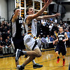 CARL RUSSO/Staff photo. Andover defeated Medford 68-60 in boys' tournament basketball action Tuesday night. Andover's Tyler Verrette sails to the hoop for the basket.   2/26/2013.