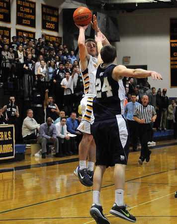 CARL RUSSO/Staff photo. Andover defeated Medford 68-60 in boys' tournament basketball action Tuesday night. Andover's David Giribaldi takes the jump shot. 2/26/2013.