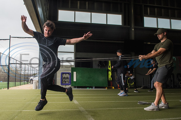 Former Bullard High School standout Nick Rumbelow, pitcher for the New York Mets, (left) works out with a resistant band with help from Riley Smith, pitcher for the Arizona Diamondbacks, during APEC MLB/Pro Media day Thursday, Jan. 23, 2020, in Tyler. (Cara Campbell/Tyler Morning Telegraph)