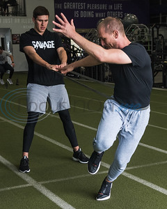 Former Whitehouse standout Josh Tomlin, MLB free agent,  (right) executes a resistance band work out with help from former Central Heights standout Grayson Rodriguez, pitcher for the Baltimore Orioles, during APEC MLB/Pro Media day Thursday, Jan. 23, 2020, in Tyler. (Cara Campbell/Tyler Morning Telegraph)