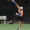 John Isner (USA) practices his serve on Monday during the Atlanta Tennis Championships at the Racquet Club of the South in Norcross, GA.