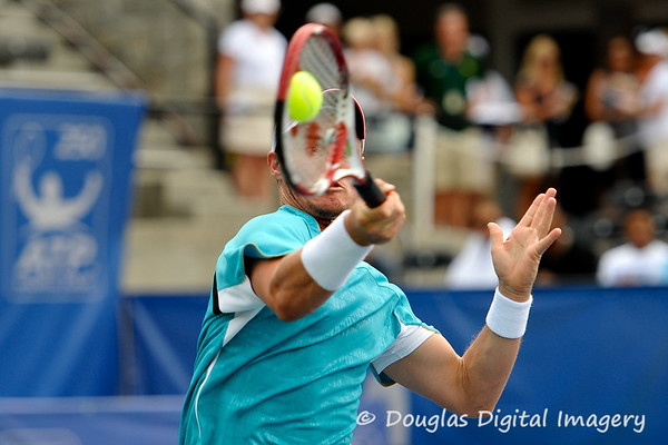 Lleyton Hewitt (AUS) watches the ball hit his racket during the first round.  Lleyton Hewitt defeated Phillip Simmonds in straight sets 6-4, 6-4 in First Round Action on Tuesday in the Atlanta Tennis Championships at the Racquet Club of the South in Norcross, GA.