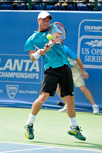 Lleyton Hewitt (AUS) smacks a two handed backhand back to Phillip Simmonds (USA) during the first round.  Lleyton Hewitt defeated Phillip Simmonds in straight sets 6-4, 6-4 in First Round Action on Tuesday in the Atlanta Tennis Championships at the Racquet Club of the South in Norcross, GA.