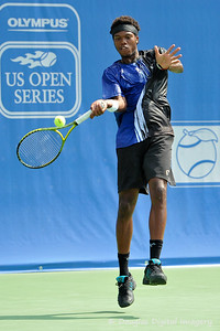 Phillip Simmonds (USA) leaps to hit a forehand during the first round.  Lleyton Hewitt defeated Phillip Simmonds in straight sets 6-4, 6-4 in First Round Action on Tuesday in the Atlanta Tennis Championships at the Racquet Club of the South in Norcross, GA.