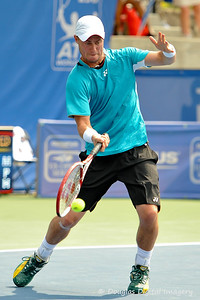 Lleyton Hewitt (AUS) reaches down for a forehand during the first round.  Lleyton Hewitt defeated Phillip Simmonds in straight sets 6-4, 6-4 in First Round Action on Tuesday in the Atlanta Tennis Championships at the Racquet Club of the South in Norcross, GA.