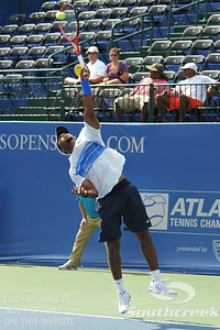 Donald Young (USA) hits a serve against Michael Russell (USA) during the first round.  Michael Russell defeated Donald Young in straight sets 6-0, 6-3 in First Round Action on Monday of the Atlanta Tennis Championships at the Racquet Club of the South in Norcross, GA.