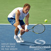 Michael Russell (USA) reaches down for a low shot during the first round.  Michael Russell defeated Donald Young in straight sets 6-0, 6-3 in First Round Action on Monday of the Atlanta Tennis Championships at the Racquet Club of the South in Norcross, GA.