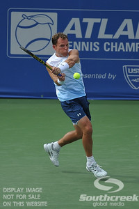 Michael Russell (USA) hits a driving backhand against Donald Young (USA) during the first round.  Michael Russell defeated Donald Young in straight sets 6-0, 6-3 in First Round Action on Monday of the Atlanta Tennis Championships at the Racquet Club of the South in Norcross, GA.