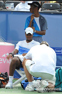 Donald Young (USA) gets treated by the trainer during the first round.  Michael Russell defeated Donald Young in straight sets 6-0, 6-3 in First Round Action on Monday of the Atlanta Tennis Championships at the Racquet Club of the South in Norcross, GA.