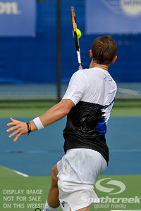 Alex Bogomolov Jr. (USA) watches the ball impact his racket on Monday during the Atlanta Tennis Championships at the Racquet Club of the South in Norcross, GA.