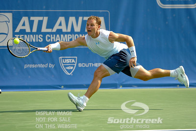 Michael Russell (USA) has to stretch way out for a forehand during the first round.  Michael Russell defeated Donald Young in straight sets 6-0, 6-3 in First Round Action on Monday of the Atlanta Tennis Championships at the Racquet Club of the South in Norcross, GA.