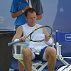 Michael Russell (USA) waits patiently while Donald Young (USA) gets treated by the trainer during the first round.  Michael Russell defeated Donald Young in straight sets 6-0, 6-3 in First Round Action on Monday of the Atlanta Tennis Championships at the Racquet Club of the South in Norcross, GA.