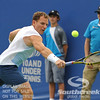 Michael Russell (USA) lunges for a backhand against Donald Young (USA) during the first round.  Michael Russell defeated Donald Young in straight sets 6-0, 6-3 in First Round Action on Monday of the Atlanta Tennis Championships at the Racquet Club of the South in Norcross, GA.