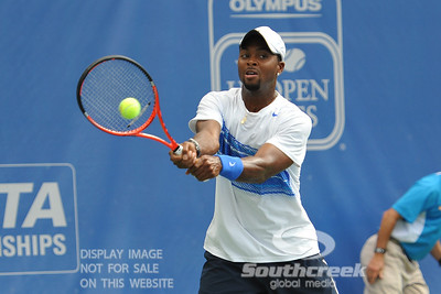 Donald Young (USA) hits a backhand against Michael Russell (USA) during the first round.  Michael Russell defeated Donald Young in straight sets 6-0, 6-3 in First Round Action on Monday of the Atlanta Tennis Championships at the Racquet Club of the South in Norcross, GA.