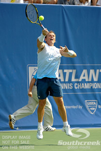 Michael Russell (USA) has to go up high for a forehand during the first round.  Michael Russell defeated Donald Young in straight sets 6-0, 6-3 in First Round Action on Monday of the Atlanta Tennis Championships at the Racquet Club of the South in Norcross, GA.