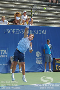 Michael Russell (USA) hits a serve against Donald Young (USA) during the first round.  Michael Russell defeated Donald Young in straight sets 6-0, 6-3 in First Round Action on Monday of the Atlanta Tennis Championships at the Racquet Club of the South in Norcross, GA.