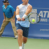Michael Russell (USA) hits a backhand against Donald Young (USA) during the first round.  Michael Russell defeated Donald Young in straight sets 6-0, 6-3 in First Round Action on Monday of the Atlanta Tennis Championships at the Racquet Club of the South in Norcross, GA.