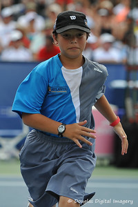 A ball boy hustles back into position during the championship match.  Mardy Fish defeated John Isner in three sets 3-6, 7-6, 6-2 in the Championship Match on Sunday in the Atlanta Tennis Championships at the Racquet Club of the South in Norcross, GA.