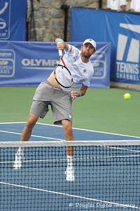 Mardy Fish (USA) hits a slam winner against John Isner (USA) during the championship match.  Mardy Fish defeated John Isner in three sets 3-6, 7-6, 6-2 in the Championship Match on Sunday in the Atlanta Tennis Championships at the Racquet Club of the South in Norcross, GA.
