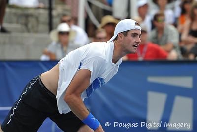 John Isner (USA) watches his serve against Mardy Fish (USA) during the championship match.  Mardy Fish defeated John Isner in three sets 3-6, 7-6, 6-2 in the Championship Match on Sunday in the Atlanta Tennis Championships at the Racquet Club of the South in Norcross, GA.