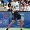 John Isner (USA) hits a forehand against Mardy Fish (USA) during the championship match.  Mardy Fish defeated John Isner in three sets 3-6, 7-6, 6-2 in the Championship Match on Sunday in the Atlanta Tennis Championships at the Racquet Club of the South in Norcross, GA.