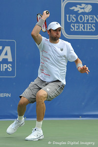 Mardy Fish (USA) follows through on a forehand against John Isner (USA) during the championship match.  Mardy Fish defeated John Isner in three sets 3-6, 7-6, 6-2 in the Championship Match on Sunday in the Atlanta Tennis Championships at the Racquet Club of the South in Norcross, GA.
