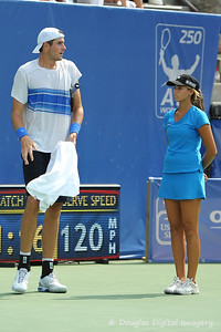 John Isner (USA) towers over the ball girl during the championship match.  Mardy Fish defeated John Isner in three sets 3-6, 7-6, 6-2 in the Championship Match on Sunday in the Atlanta Tennis Championships at the Racquet Club of the South in Norcross, GA.