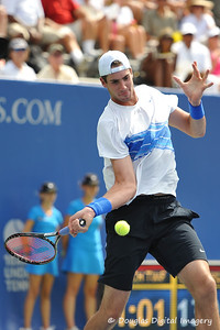 John Isner (USA) hits a forehand during the championship match.  Mardy Fish defeated John Isner in three sets 3-6, 7-6, 6-2 in the Championship Match on Sunday in the Atlanta Tennis Championships at the Racquet Club of the South in Norcross, GA.
