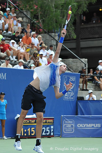 John Isner (USA) serves to Mardy Fish (USA) during the championship match.  Mardy Fish defeated John Isner in three sets 3-6, 7-6, 6-2 in the Championship Match on Sunday in the Atlanta Tennis Championships at the Racquet Club of the South in Norcross, GA.