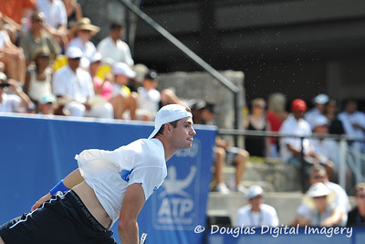 John Isner (USA) serves to an explosion of sweat during the championship match.  Mardy Fish defeated John Isner in three sets 3-6, 7-6, 6-2 in the Championship Match on Sunday in the Atlanta Tennis Championships at the Racquet Club of the South in Norcross, GA.