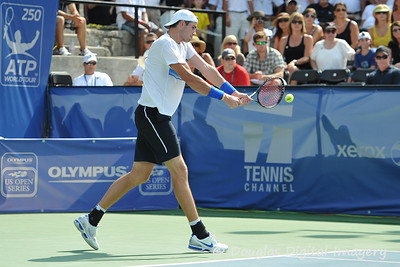John Isner (USA) hits a backhand during the championship match.  Mardy Fish defeated John Isner in three sets 3-6, 7-6, 6-2 in the Championship Match on Sunday in the Atlanta Tennis Championships at the Racquet Club of the South in Norcross, GA.