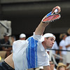 John Isner (USA) serves during the championship match.  Mardy Fish defeated John Isner in three sets 3-6, 7-6, 6-2 in the Championship Match on Sunday in the Atlanta Tennis Championships at the Racquet Club of the South in Norcross, GA.