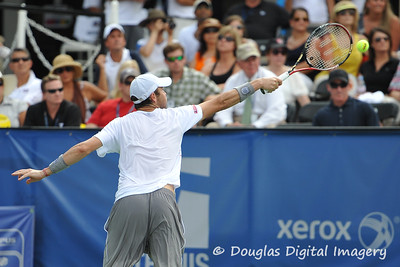 Mardy Fish (USA) has to go up high for a John Isner (USA) serve during the championship match.  Mardy Fish defeated John Isner in three sets 3-6, 7-6, 6-2 in the Championship Match on Sunday in the Atlanta Tennis Championships at the Racquet Club of the South in Norcross, GA.