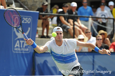 John Isner (USA) reaches for a forehand during the championship match.  Mardy Fish defeated John Isner in three sets 3-6, 7-6, 6-2 in the Championship Match on Sunday in the Atlanta Tennis Championships at the Racquet Club of the South in Norcross, GA.
