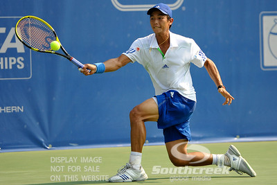 Yen-Hsun Lu (TPE) reaches out for a forehand against John Isner (USA) during their quarterfinal match.  John Isner defeated Yen-Hsun Lu in straight sets 6-1, 6-2 in Quarterfinal Action on Friday  in the Atlanta Tennis Championships at the Racquet Club of the South in Norcross, GA.