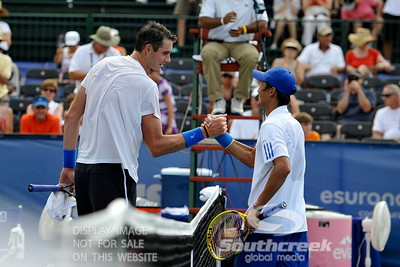 John Isner (USA) and Yen-Hsun Lu (TPE) shake hands after their quarterfinal match.  John Isner defeated Yen-Hsun Lu in straight sets 6-1, 6-2 in Quarterfinal Action on Friday  in the Atlanta Tennis Championships at the Racquet Club of the South in Norcross, GA.