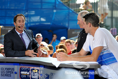 ESPN's Darren Cahill poses a question to John Isner (USA) while Brad Gilbert listens in the post match interview.  John Isner defeated Yen-Hsun Lu in straight sets 6-1, 6-2 in Quarterfinal Action on Friday  in the Atlanta Tennis Championships at the Racquet Club of the South in Norcross, GA.
