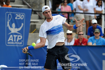 John Isner (USA) hits a forehand against Yen-Hsun Lu (TPE) during their quarterfinal match.  John Isner defeated Yen-Hsun Lu in straight sets 6-1, 6-2 in Quarterfinal Action on Friday  in the Atlanta Tennis Championships at the Racquet Club of the South in Norcross, GA.