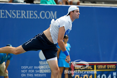 John Isner (USA) watches his serve during the quarterfinal match.  John Isner defeated Yen-Hsun Lu in straight sets 6-1, 6-2 in Quarterfinal Action on Friday  in the Atlanta Tennis Championships at the Racquet Club of the South in Norcross, GA.