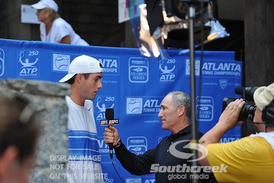 ESPN's Brad Gilbert interviews John Isner (USA) before his quarterfinal match.  John Isner defeated Yen-Hsun Lu in straight sets 6-1, 6-2 in Quarterfinal Action on Friday  in the Atlanta Tennis Championships at the Racquet Club of the South in Norcross, GA.