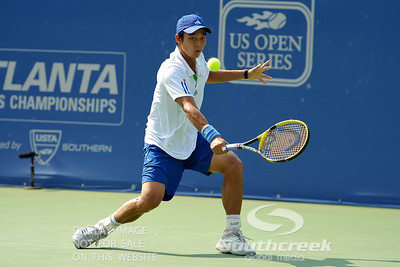 Yen-Hsun Lu (TPE) fends off another shot with a slice against John Isner (USA) during their quarterfinal match.  John Isner defeated Yen-Hsun Lu in straight sets 6-1, 6-2 in Quarterfinal Action on Friday  in the Atlanta Tennis Championships at the Racquet Club of the South in Norcross, GA.