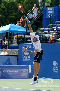 John Isner (USA) hits a powerful first serve again Yen-Hsun Lu (TPE) during their quarterfinal match.  John Isner defeated Yen-Hsun Lu in straight sets 6-1, 6-2 in Quarterfinal Action on Friday  in the Atlanta Tennis Championships at the Racquet Club of the South in Norcross, GA.