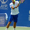 Yen-Hsun Lu (TPE) returns a serve by John Isner (USA) during their quarterfinal match.  John Isner defeated Yen-Hsun Lu in straight sets 6-1, 6-2 in Quarterfinal Action on Friday  in the Atlanta Tennis Championships at the Racquet Club of the South in Norcross, GA.