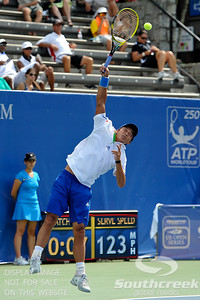 Yen-Hsun Lu (TPE) serves to John Isner (USA) during their quarterfinal match.  John Isner defeated Yen-Hsun Lu in straight sets 6-1, 6-2 in Quarterfinal Action on Friday  in the Atlanta Tennis Championships at the Racquet Club of the South in Norcross, GA.
