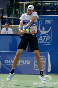 John Isner (USA) hits a jumping backhand against Yen-Hsun Lu (TPE) during their quarterfinal match.  John Isner defeated Yen-Hsun Lu in straight sets 6-1, 6-2 in Quarterfinal Action on Friday  in the Atlanta Tennis Championships at the Racquet Club of the South in Norcross, GA.